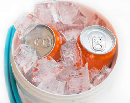 ice crushed: cans of drink on crushed ice.