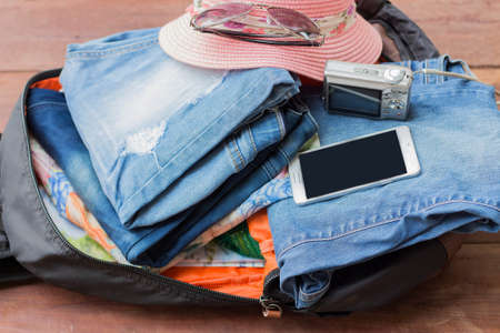 overburden: Prepare a bag of clothes and accessories for the holidays. Stock Photo