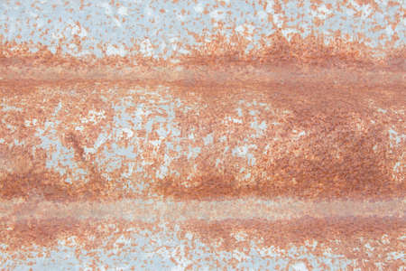 corrugated steel: Rusty old corrugated metal sheets.
