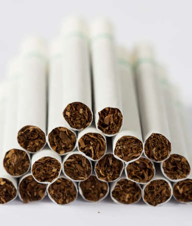 fag: Cigarettes stack on a white background.