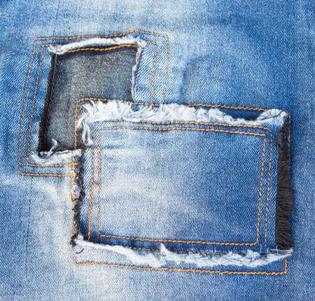 torn: Jeans torn denim texture. Stock Photo