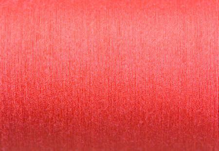 hilo rojo: red thread roll  background. Foto de archivo