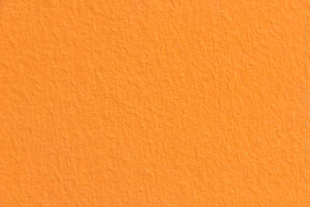 wall with orange color and brushed photo
