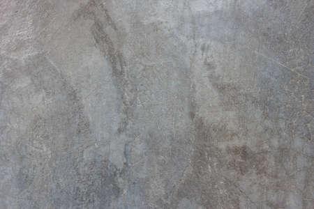 긁힌 자국이와 회색 광택 콘크리트 벽의 질감