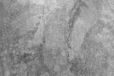 Textur der grauen polierten Betonwand mit Kratzern