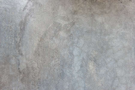 polished: texture of the gray polished concrete wall with scratches