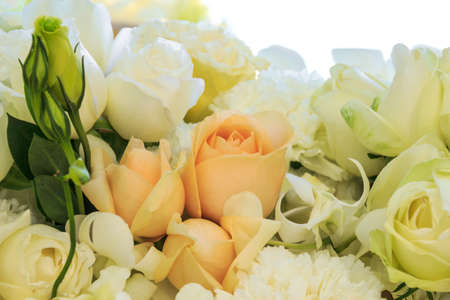 Bouquet of white and orange roses with carnation flower photo