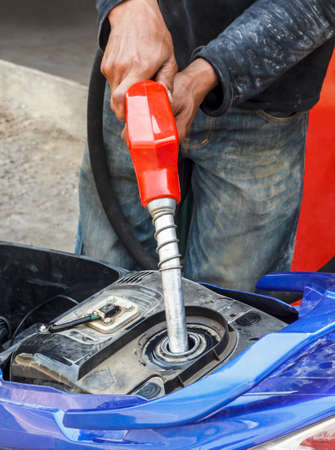 Refueling a motorcycle at a gas station  photo