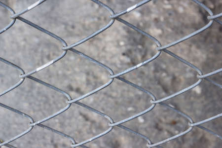 Old iron wire fence, close-up wire mesh fence photo
