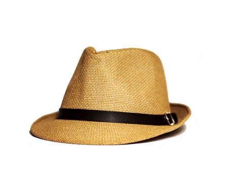 Mooie strooien hoed op een witte achtergrond, bruine strooien hoed op een witte achtergrond Stockfoto