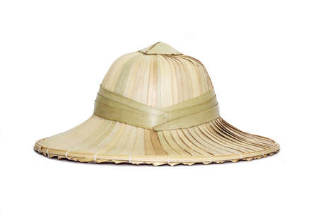 Weaving hat isolated on white background, sun helmet made of palm leaves photo