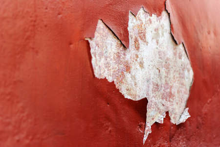 peeling paint on an old house wall photo