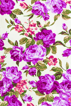 Rose Fabric background, Fragment of colorful retro tapestry text on pink background, Fragment of colorful retro tapestry textile pattern with floral ornament useful as background photo