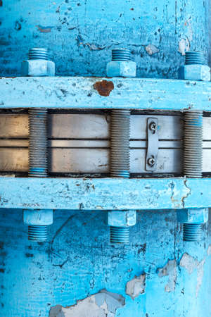 nuts and bolts corrode and damaged paint , old peeling paint and dirty on old blue concrete wall background photo