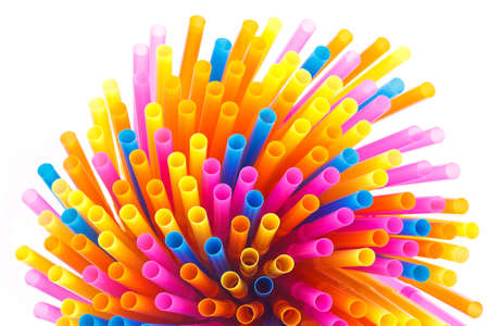 Colorful straws  on a white background photo