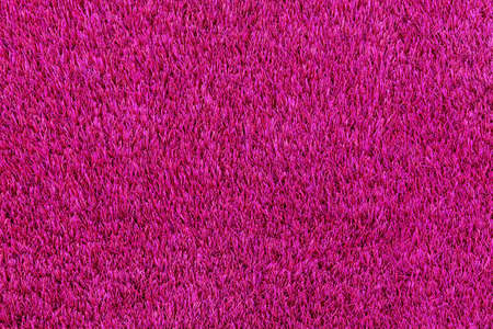 Pink artificial turf taken from the top and background