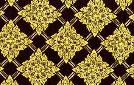 Thailand striped pattern on the wall,Thai traditional art. Thai Art Background, Thai art yellow pattern on black background photo