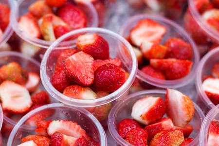 dissect: Strawberry sliced in the plastic cup