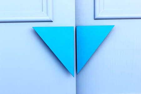 Close up  wooden blue door handle triangle modern on gray wooden door background photo