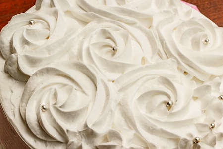 desing: Beautiful and tasty white cake with cream desing pattern rose