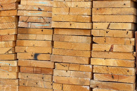 wood cut: Background of Stacked Wood Cut in Squared Timber Stock Photo
