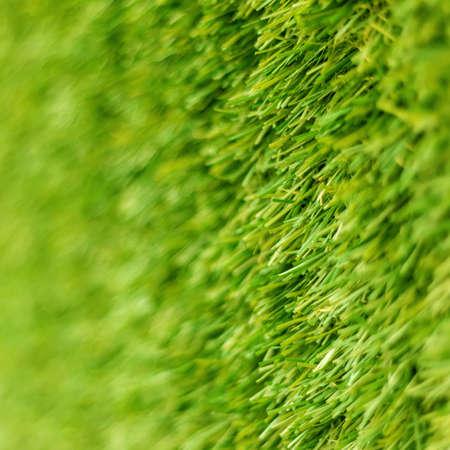 Artificial grass sport field blur wall background