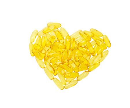 Fish oil pills in shape heart isolated on white background Reklamní fotografie