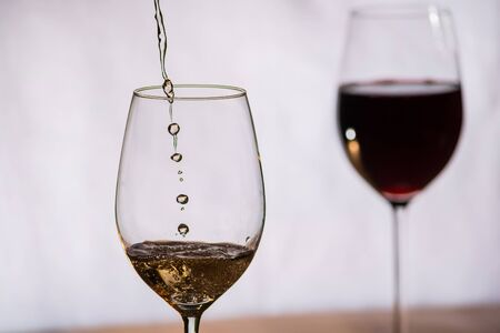 wine and dine: Wine gets filled into a glass Stock Photo
