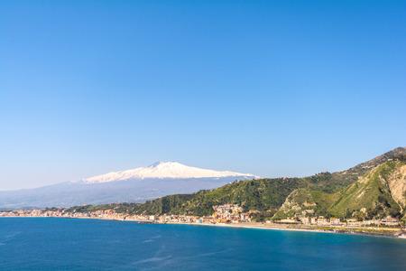taormina: City of Taormina in Sicily with vulcano Etna in background Stock Photo