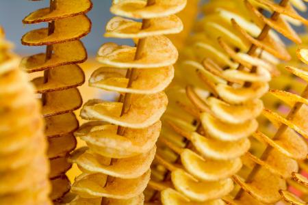 Fry twist slice potato insert on bamboo Reklamní fotografie - 43527351