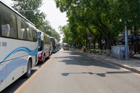 busses: BEIJING, CHINA - MAY 22, 2016: Busses on crowded road close to Wangfujing Street in Beijing China