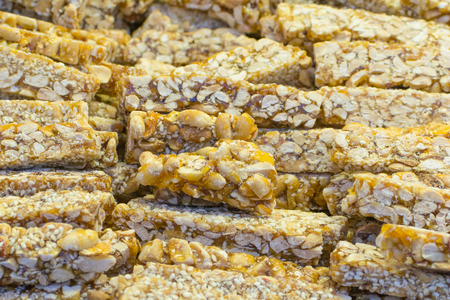 gastronome: Asian dessert out of different nuts and sesame served on the street in Beijing