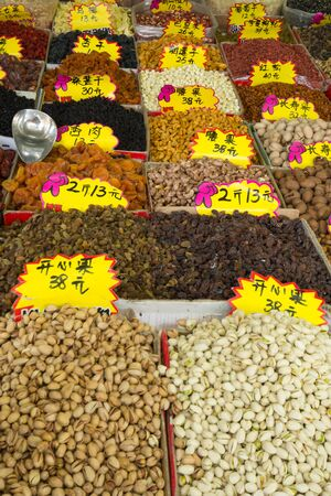 Different nuts and dried fruits on open asian market