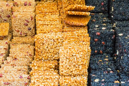 sesame street: Asian dessert in different colours out of different nuts and sesame served on the street in Beijing