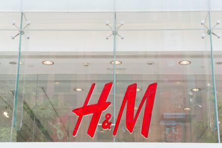 hm: BEIJING, CHINA - MAY 22, 2016: Company sign of H&M on Wangfujing Street in Beijing China