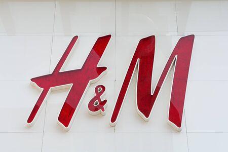shopfront: BEIJING, CHINA - MAY 22, 2016: Company sign of H&M on Wangfujing Street in Beijing China