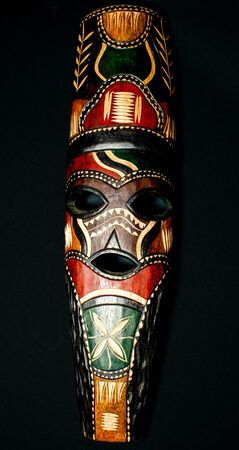 Low Key of hand made wooden mask from Africa, Swasiland