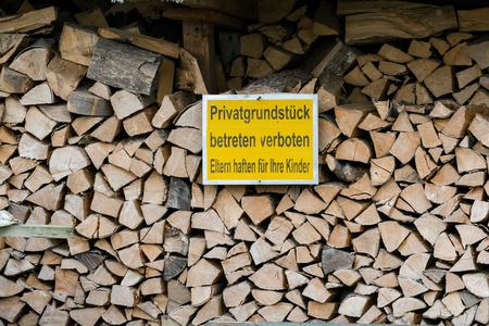 robbing: Wood stack, with forbitten to enter sign to prevent robbing Stock Photo