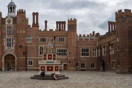 Hampton Court Palace with green Gardens