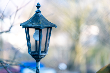 detailed view of ancient street light during day time