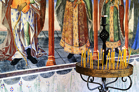 fresco: Lighted candles in front of the monastery fresco