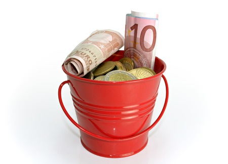 bucket of money: Small red bucket full of money isolated on white background