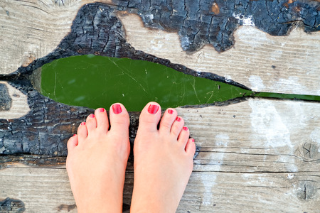 human foot: View from above on the bare feet and toes Stock Photo