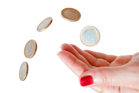 Coins and female hand isolated on white background