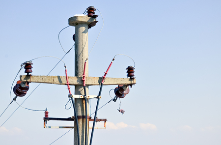 three phase: Closeup of simple three-phase electric pole with the sky in background
