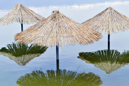 sunshades: Reed sunshades flooded after havy rains connected with climate changes