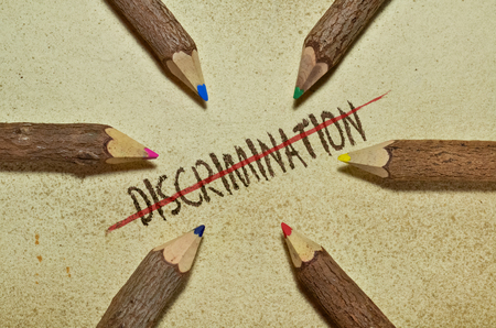 Conceptual image with pencils on vintage background to stop discrimination Stock Photo