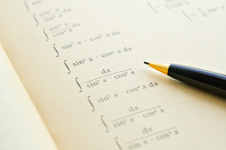 differential: Closeup of an open mathematical book on differential and integral calculus