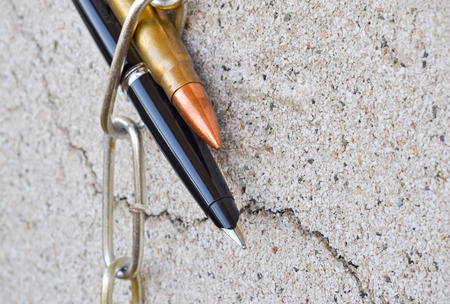 symbolically: Pencil chain and bullet symbolically reflect the the situation in the politics Stock Photo