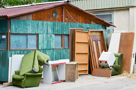 old furniture: Old furniture thrown in front of the house after renovation Stock Photo